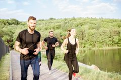 Friends jogging outdoors Stock Photography