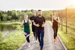Friends jogging outdoors Royalty Free Stock Photography