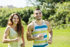 Friends jogging on summer morning Stock Image