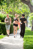 Friends jogging together in a park Royalty Free Stock Image