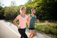 Friends jogging together Stock Images