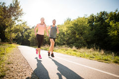Friends jogging together Royalty Free Stock Photo