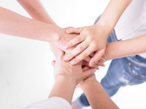 Friends join hands Stock Photos