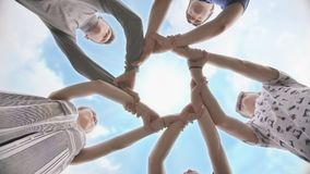 Friends join their hands in a circle. The concept of strong friendship. stock footage