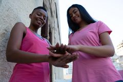 Friends joining hands for breast cancer awareness. Low angle view royalty free stock photos