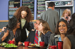 Friends Joking During Lunch Stock Photo