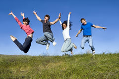 Friends jumping Stock Photography