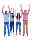 Friends jumping with arms raised Royalty Free Stock Images