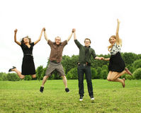 Friends jumping outdoor Royalty Free Stock Image