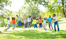 Friends jumping in park Stock Photo