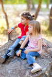 Friends kid girls playing in forest rock Royalty Free Stock Photography