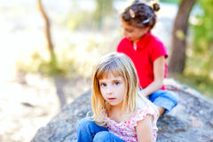 Friends kid girls playing in forest rock Stock Image