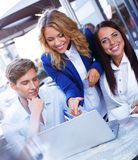 Friends with laptop Stock Images