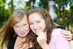 Friends laughing. Two lovely teenage friends laughing Stock Images