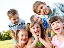Friends laughing. Six preschool friends looking in camera and laughing Stock Photography