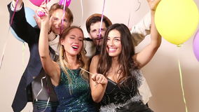 Friends Laughing And Enjoying In Party Photo Booth Royalty Free Stock Images