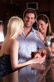 Friends laughing at bar. Smiling royalty free stock photos