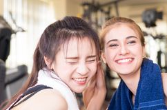 Friends laughing and having fun in fitness gym Stock Image