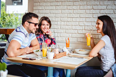 Friends laughing at the lunch. In the restaurant Royalty Free Stock Photography
