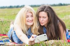 Friends laughing and making selfie Stock Images