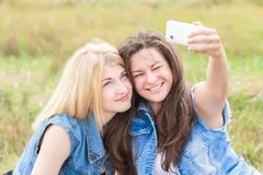 Friends laughing and taking picture Royalty Free Stock Photography