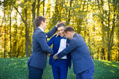 Friends laughing at the wedding of a friend Royalty Free Stock Image