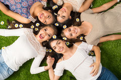 Friends Laying In The Grass Stock Image