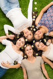 Friends Laying In The Grass Stock Photo