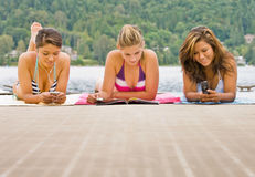 Friends laying on pier Stock Photography
