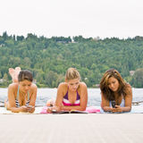 Friends laying on pier Royalty Free Stock Images