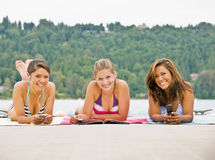 Friends laying on pier Royalty Free Stock Photo