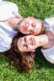 Friends laying side by side on park Royalty Free Stock Images