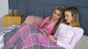 Friends leisure trust sharing secret girls pastime. Friends leisure. comfy trusting relationship. calm pastime. sharing secrets thought and dreams. girls laying stock video