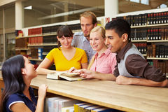 Friends in library Stock Image