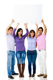 Friends lifting a banner Stock Image