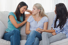 Friends listening to crying woman Royalty Free Stock Images