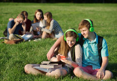 Friends Listening to MP3 Player Stock Image