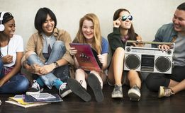 Friends listening to music concept Stock Image