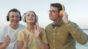 Friends Listening to the Music in Headphones stock footage