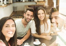Friends at the local coffee shop. Friends having a great day at the local coffee shop Stock Photos