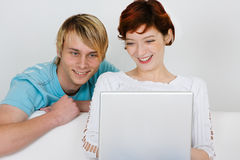 Friends looking at computer Royalty Free Stock Photography