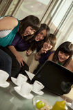 Friends looking at laptop Stock Photography