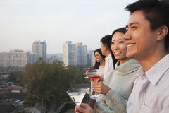 Friends Looking Out Over Cityscape Royalty Free Stock Images