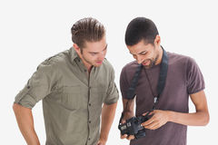Friends looking at photo on camera Royalty Free Stock Photo