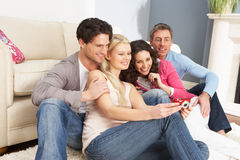 Friends Looking At Pictures On Digital Camera Stock Photos