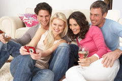 Friends Looking At Pictures On Digital Camera Royalty Free Stock Photos