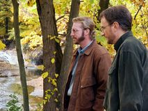 Friends looking at ravine. Two men observing nature's glory in autumn Stock Photography