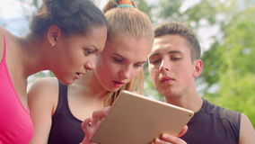 Friends looking tablet. Shocked faces. Surprised people. Young people tablet stock video