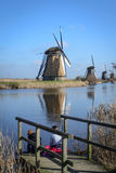 Friends looking at windmill Stock Image