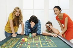 Friends Losing On Roulette Table Royalty Free Stock Image